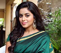 Poorna (Posters) Photos